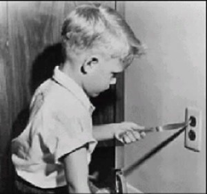 boy-sticking-knife-into-socket