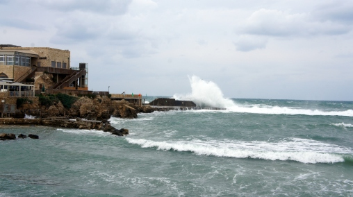 Large seas crashing on what was once a dockside building