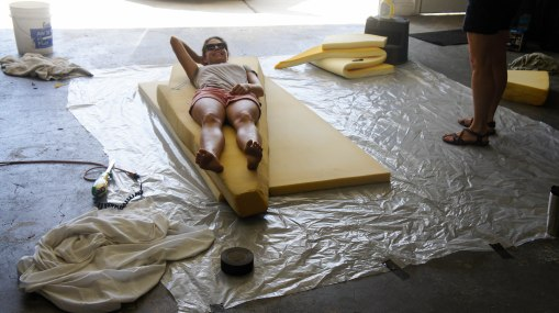 The Chief lounging on the future v-birth mattress