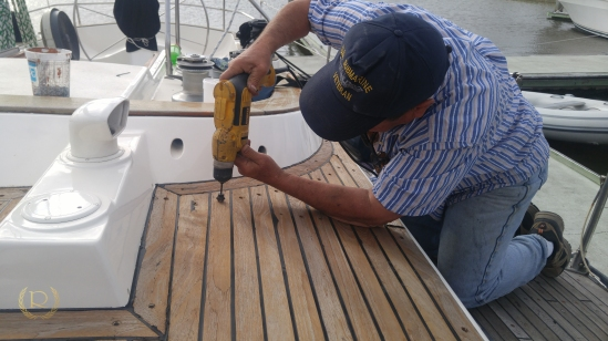 Re-countersinking the old holes, be sure to set your depth on this so you don't take too much wood away!